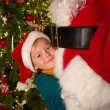 Big hug for santa claus — Stockfoto