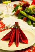 Folded napkins on christmas table — Stock Photo