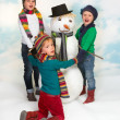 Dancing around the snowman — Stock Photo