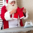 Santa with a laundry problem — Stock Photo
