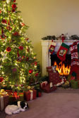Fireplace and christmas tree — Stock Photo