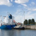 Cargo ship passing lock in Antwerp port — Stock Photo