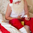 Santa Claus with stomach ache — Stock Photo