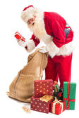 Santa Claus found his gift — Stock Photo