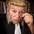Judge with monocle — Stock Photo