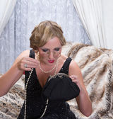 Flapper dress lady with lorgnette — Stock Photo