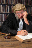 Bored judge in court — Stock Photo