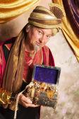Genie with treasure chest — Stock Photo