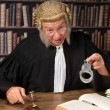 Judge showing handcuffs — Stock Photo