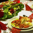 Ornate christmas dinner with lobster — Stockfoto