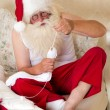 Santa Claus doing mending socks — Stock Photo
