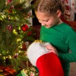 Christmas stocking and a girl — Stock Photo