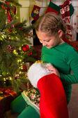 Christmas stocking and a girl — Photo