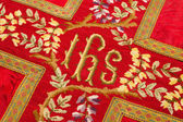 Holy IHS on vestment — Stock Photo