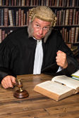 Judge with hammer — Stock Photo
