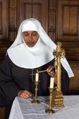 Nun and altar — Stock fotografie