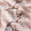 Pocket watch on lace — Stock Photo