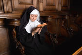 Praying novice nun — Stock Photo