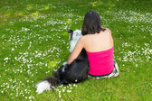 Dog and woman in the park — Stock Photo