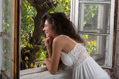 Smiling window girl — Stockfoto