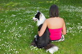 Relaxing with her dog — Stock Photo