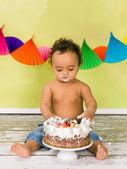 Tasting birthday cake — Stock Photo