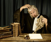 Judge scratching head — Stock Photo