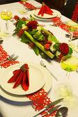Flower arrangement on Christmas table — Stock Photo