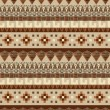 Stock Vector: Seamless tribal pattern in brown tints