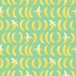 Seamless pattern with bananas on green background — Stock Vector