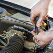 Stock Photo: Car mechanic at work