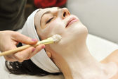 Beautician applies a fask mask — Stock Photo