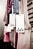 Boutique clothing rack with Sale tag — Stock Photo