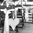Wedding chairs with heart decoration, black and white — Stock Photo