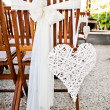 Stock Photo: Wedding chairs with heart decoration