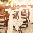 Stock Photo: Wedding chairs with heart decoration, with solar flare
