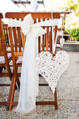 Wedding chairs with heart decoration — Stock Photo