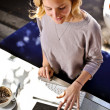 Woman using computer, table in cafe — Stock Photo