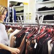 Woman shopping in boutique — Stock Photo #25013911