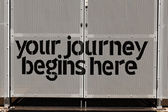 "Gate with ""your journey begins here"" — Stock Photo"