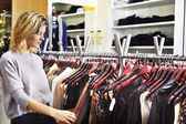 Woman shopping in boutique — Stock Photo
