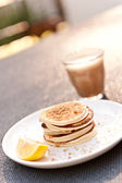 Weekend breakfast of mini pancakes and cafe latte — Stock Photo