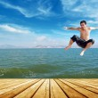 Beach jumping man — Foto Stock