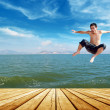 Beach jumping man — Stock fotografie