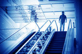Man on the escalator — Stock Photo