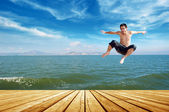 Beach jumping man — Stock Photo