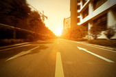 Road in city with sunset — Stock Photo