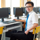 Asian man working in the computer room — Stock Photo
