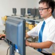 Asian man working in the computer room — Stock Photo #17931125