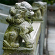 Lion statue on bridge in china — Stock Photo